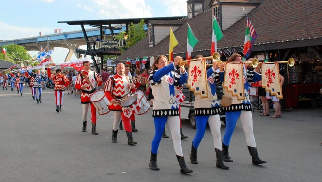 The Flag-Throwers from Florence, Italy, parade through the grounds of Maier Festival Park in this undated photo.