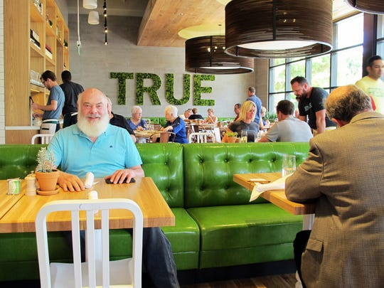 Dr. Andrew Weil, a celebrity holistic health guru, sits in March at True Food Kitchen, the restaurant he recently opened at Waterside Shops in Naples.