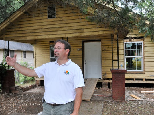 Mike Bunce, founder and executive director of House to House, talks about a house on Oak Street that they are renovating in west Montgomery on Friday, July 18, 2014.