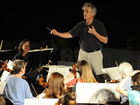 Montgomery Symphony Orchestra conductor Thomas Hinds leads the orchestra in rehearsal on Wednesday September 10, 2014 on the grounds of the Alabama Shakespeare Festival in Montgomery, Ala. for the Thursday night Broadway Under the Stars concert.