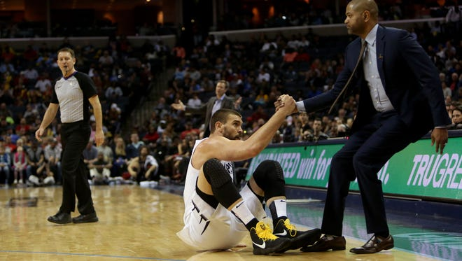 March 15, 2018 - Memphis Grizzlies center Marc Gasol (33) is helped to his feet by interim head coach J.B. Bickerstaff after being fouled by the Chicago Bulls during the fourth quarter at FedExForum on Thursday night in Memphis.
