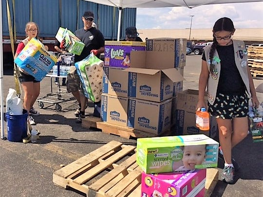 Girls Scouts members help organize donations for Houston