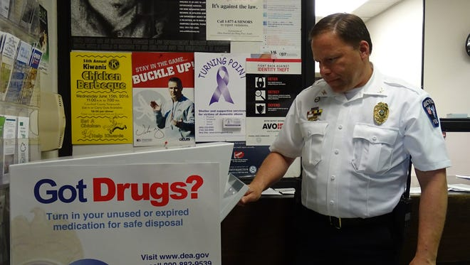 Chief David Koepke of the Bucyrus Police Department takes a look inside the drug takeback box that has been located inside the station for the past year.
