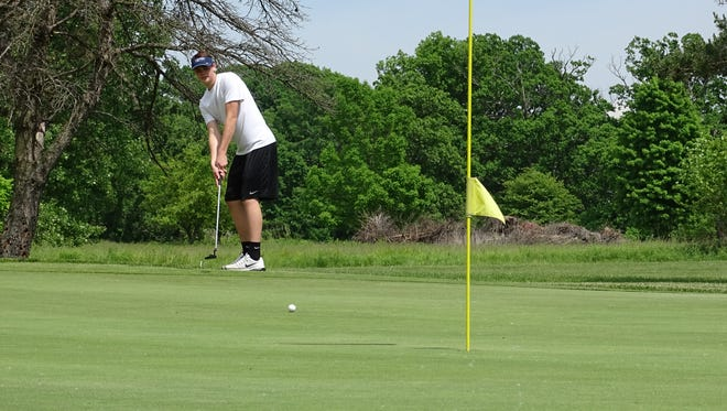 Brandon Shutler of Bucyrus putts toward the cup Tuesday at the Golf Club of Bucyrus. Shutler, will be a senior this fall at Wynford High School.