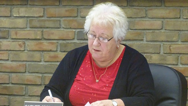 """Bucyrus City Council President Garnet """"Sis"""" Love jots down 6:30 p.m. Jan. 10 as the date for the city's public hearing regarding outdoor seating in the downtown area."""