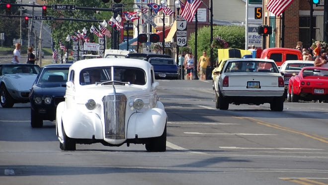 Hundreds of cars cruise up and down Sandusky Avenue in Bucyrus every June during Cruisin' with the Cops.