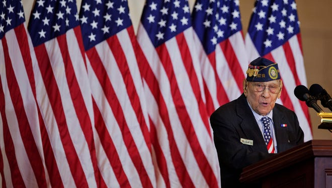 Celestino Almeda, 100, speaks during a ceremony  awarding the Congressional Gold Medal to Filipino veterans of World War II in Emancipation Hall in the U.S. Capitol in Washington on Oct. 25, 2017.