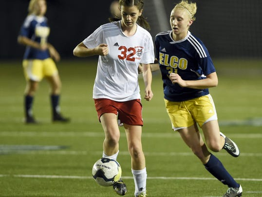 Elco's Kaela Gettle (31) goes toe to toe with Fleetwood's Lauren Hughes during the district semifinals in Hershey Monday night.
