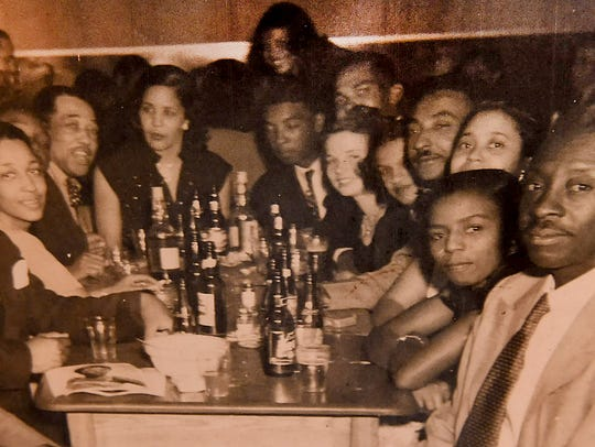 A photo shows jazz great Duke Ellington, far left,