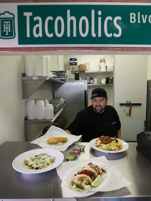 Tacoholics owner Jessie Peña prepares dishes at 1613 N. Zaragoza Road, Suite 201.