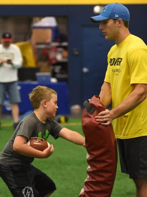 Detroit Lions running back and SDSU alum Zach Zenner works with kids at the Sanford Power Riggs Premier Football Academy Thursday, June 21, 2018 at Sanford Fieldhouse in Sioux Falls, S.D.