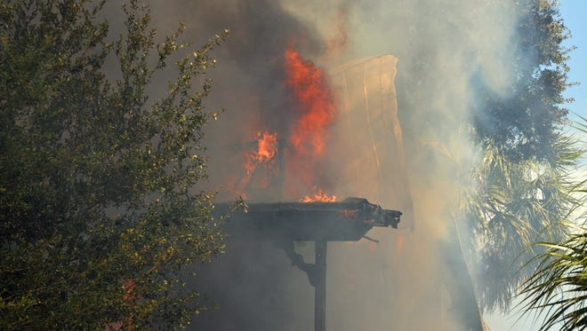 A house built in 1893 that is on the Brevard Register of Historic Buildings was destroyed by fire onThursday afternoon.