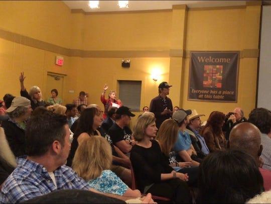 Songwriter Trey Bruce speaks at the community meeting