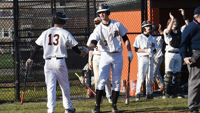 Marlboro's Nicholas Rabe, center, congratulates teammate Austin Casey, left, after he scores during an April 5 game against Red Hook.