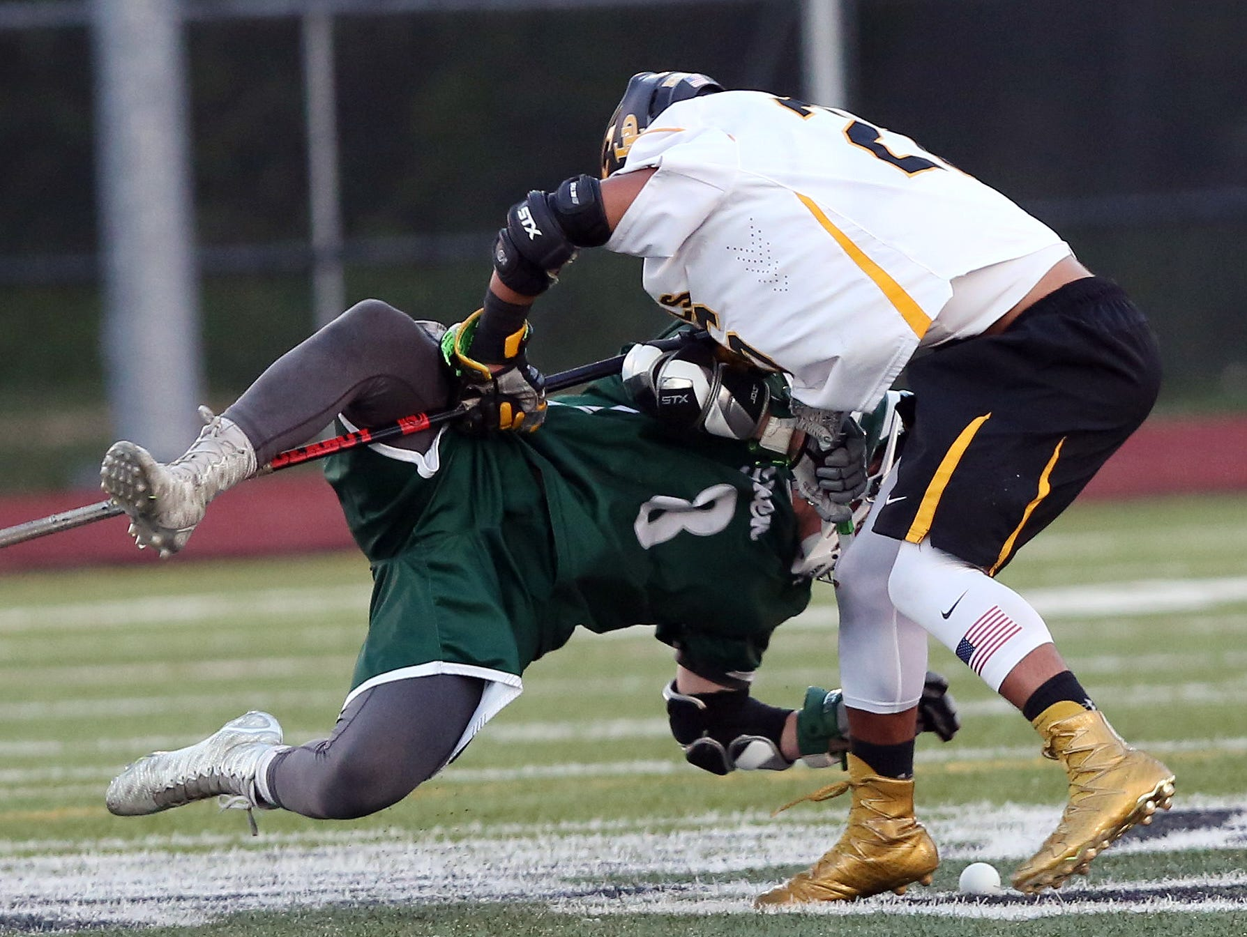 Lakeland/Panas' Nicholas Vazquez, right, wins a faceoff battle with Shenendehowa's Hayden Haldane during a Class A regional semifinal at Yorktown High School Wednesday. Lakeland/Panas won the game 8-7.
