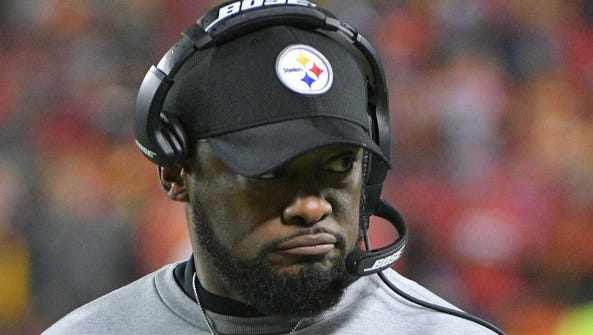 Pittsburgh Steelers head coach Mike Tomlin looks on