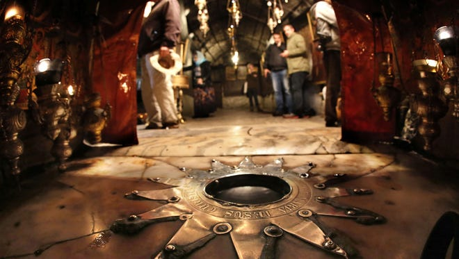 The Bethlehem star is inside the Grotto at the Church of the Nativity, revered as the site of Jesus' birth, in the West Bank town of Bethlehem on Dec. 18.