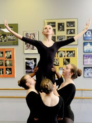 Grayson Boswell is lifted during her dance routine at Carol Anglin Dancenter.