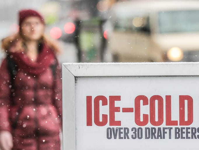 A bar in Broad Ripple Village advertises 'Ice Cold