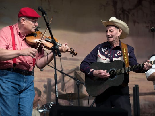 Terry Huval, left, and D. L. Menard perform during Menard's 82nd birthday party held last April at the Liberty Theater in Eunice.