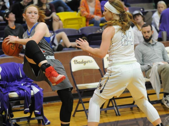 Cooper's Hannah McGuire, left, looks to pass the ball after keeping a loose ball from sailing out of bounds while Merkel's Karsen Sutterfield defends. The Lady Badgers beat Cooper 37-33 in the nondistrict game Tuesday, Dec. 16, 2016 in Merkel.