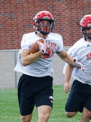 A Wausau East player runs downfield during practice
