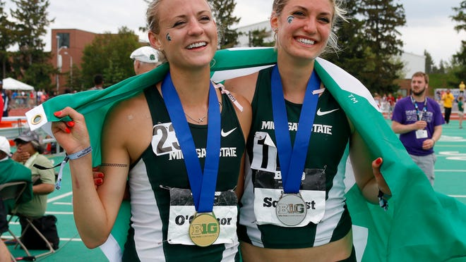 MSU's Leah O'Connor, left, and Rachele Schulist celebrate after placing first and second, respectively, in the 5,000-meter during the Big Ten Track and Field championship Sunday in East Lansing.