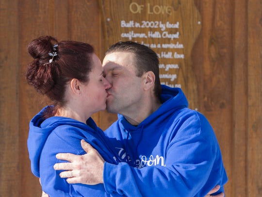 Kissing as husband and wife outside of Hell's Chapel