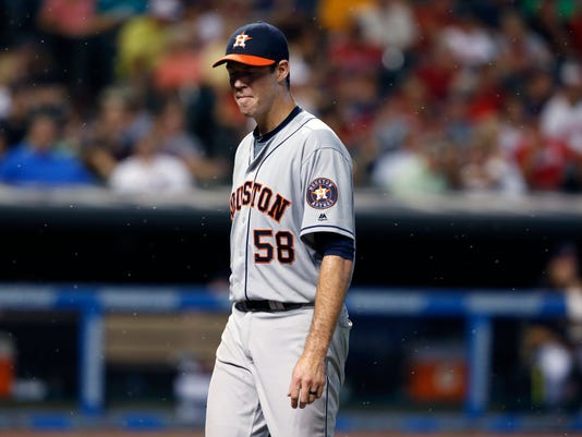 Houston Astros starting pitcher Doug Fister walks off the field through a swarm of bugs after being pulled during the fifth inning of a baseball game against the Cleveland Indians on Wednesday, Sept. 7, 2016, in Cleveland. (AP Photo/Ron Schwane)