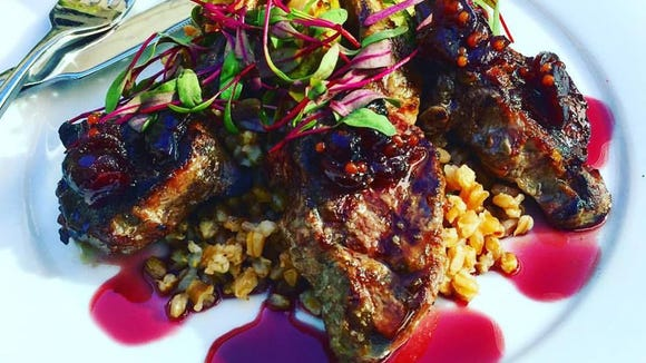 Grilled Grass-Fed Lamb Chops are prepared with Castle Valley Mill's Cider Infused Farro, Roasted Brussels Sprouts, Cranberry-Orange Mostarda in a Pinot Noir Gastrique.