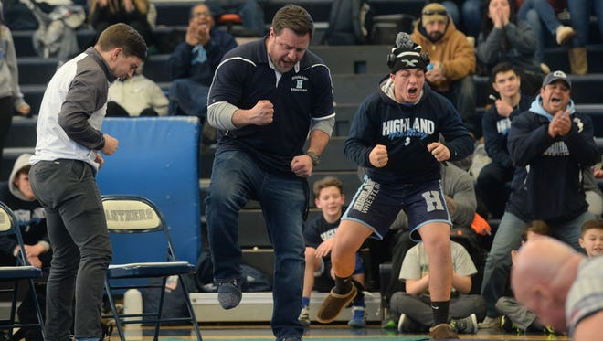 Mike Davidson, center, celebrates a pin from Highland's Brody Colbert in the Dan Trainer Duals on Jan. 6 at Collingswood High School.