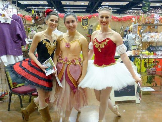 "Three ballerinas from ""The Nutcracker"" ballet helped"