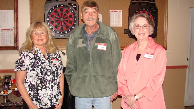 Initiation Ceremonies were conducted recently at the Elks Lodge in Mountain Home as three Arkansans joined the group. Shown are, from left, Shirley Bouchard,  Albert Porter and Diane Miller. Don Swanson, exalted ruler, presided over the Rite of Initiation and approximately 200 members attended. The Benevolent and Protective Order of Elks is one of the oldest fraternal organization in the United State and boasts of more than 1 million members in 2,000 lodges throughout the nation. Lodge 1714 in Mountain Home serves more than 800 members in Baxter and surrounding counties. Elks are well known for their many community activites including sponsorship of Boy and Girl Scouts and other sports ventures for youth