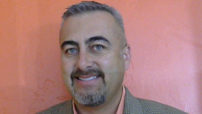 John L. Vasquez