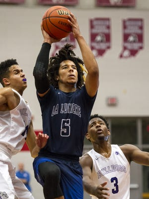 La Lumiere High School senior Tyger Campbell (5) puts up a shot during the first half of an Hendricks County Hoop Fest Tournament basketball game Friday, December 1, 2017, at Danville High School.