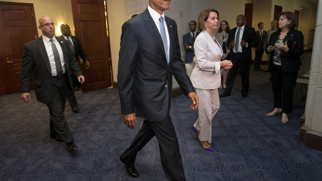 FILE - In this June 12, 2015 file photo, President Barack Obama and House Minority Leader Nancy Pelosi of Calif. leave meeting with House Democrats on Capitol Hill in Washington to discuss the global trade talks. The president will meet with pro-trade Democrats from Senate and House, trying to salvage trade agenda. (AP Photo/Pablo Martinez Monsivais)
