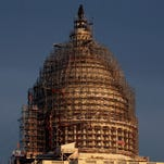 The U.S. Capitol dome is seen under repair on Capitol Hill on Nov. 22, 2015.