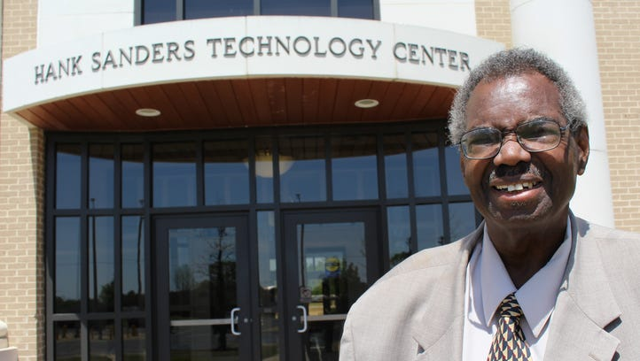 State Sen. Hank Sanders stands in front of a technology