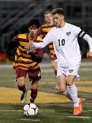 Vestal's Parker McKnight, right, and Ithaca's Roberto Mier chase down the ball during the STAC final Oct. 16 at Vestal. Both players were named first-team  Large School all-state picks.