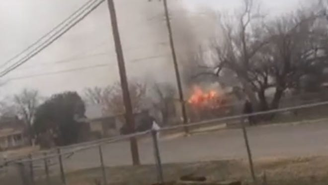 Police have cordoned off an area of the city's North Side after gunfire erupted from a burning house