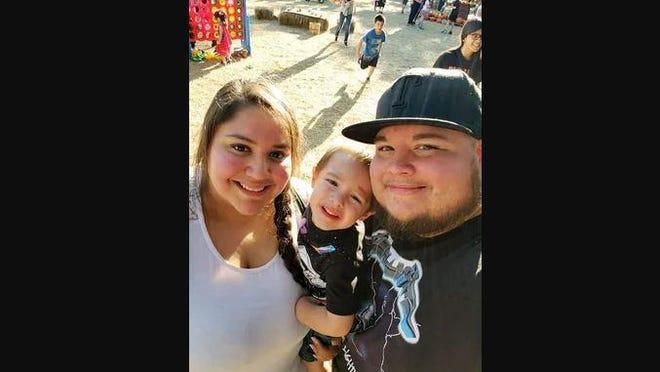 Mariah, Raiden and Adan Gonzalez pose for a photo.