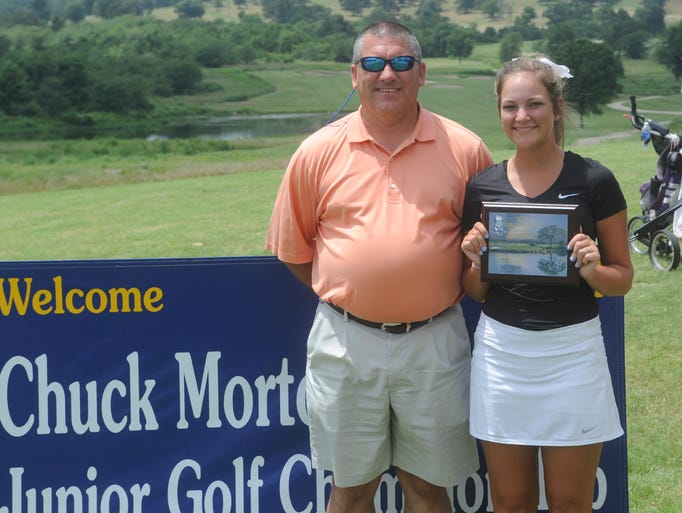 Allie Weiner of Maumelle holds the first-place plaque for the girls' 14-15 age division after the 13th annual Chuck Morton Memorial Junior Golf Tournament at Big Creek Golf & Country Club.