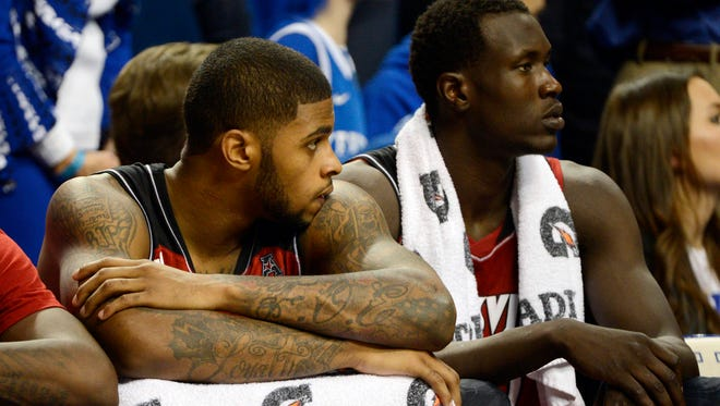 Louisville Cardinals forward Chane Behanan (21) and forward/center Mangok Mathiang (12) look on from the bench during the second half against the Kentucky Wildcats at Rupp Arena. Kentucky defeated Louisville 73-66.