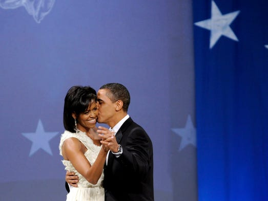 President Obama and Michelle dance during the Biden