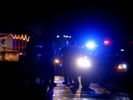 Farmington police are pictured at the scene of an officer-involved shooting Wednesday off the Bloomfield Highway.