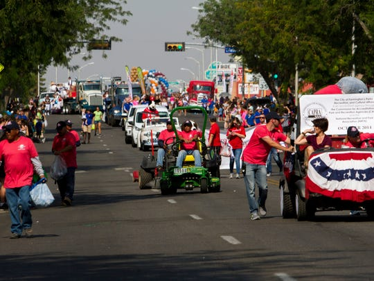 Participants in the Connie Mack World Series parade proceed down Farmington's West Main Street Thursday. Participants in the Connie Mack World Series parade proceed down West Main Street Thursday in downtown Farmington.