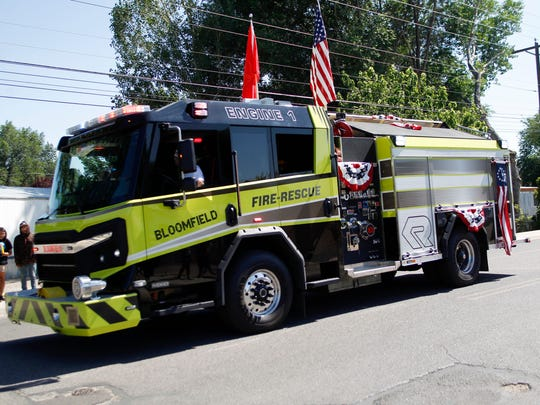 The Bloomfield Fire Department's new Engine 1 fire truck is displayed during the Bloomfield Olde Tyme Family Fourth parade along Blanco Boulevard.