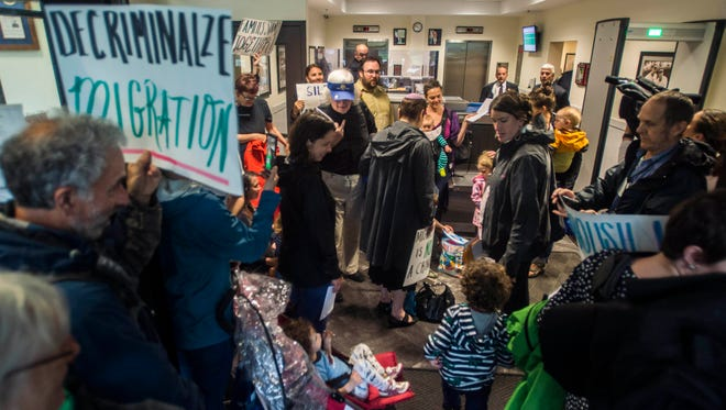 A group of about 45 parents, many with small children and infants, entered the security lobby of the Federal Building in downtown Burlington, Vt. asking to meet with U.S. Attorney Christina Nolan about resisting immigration policy set down by President Trump and Attorney General Jeff Sessions, specifically the practice of separating undocumented immigrant children from their parents.