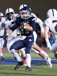 Chambersburg's Clay Myers (33) drives the ball past
