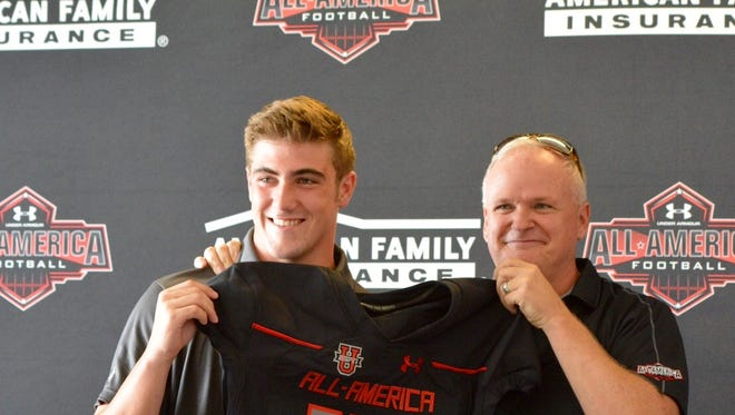 Desert Ridge senior long snapper Adam Bay received his American Family Insurance Under Armour All-American Football Game jersey during a ceremony at school on Tuesday.